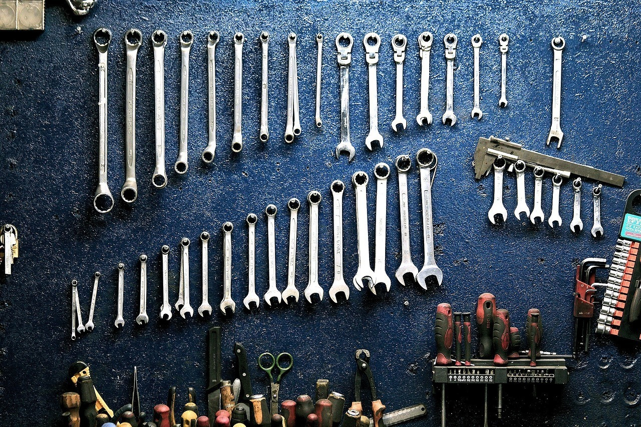 A row of spanners (wrenches) on the wall of a workshop indicating performance tuning and maintenance.