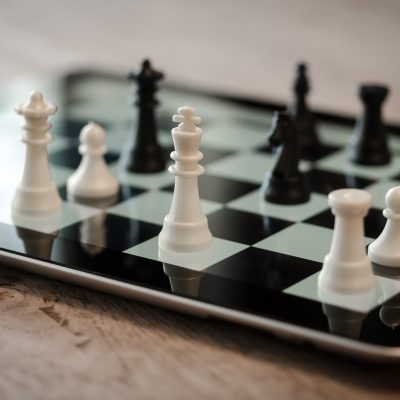 Chess pieces on an iPad - strategy and technology combined.